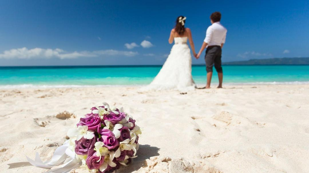 A couple at the beach after their wedding in the Dominican Republic
