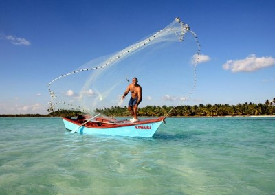 A fisherman throwing out his fishing net