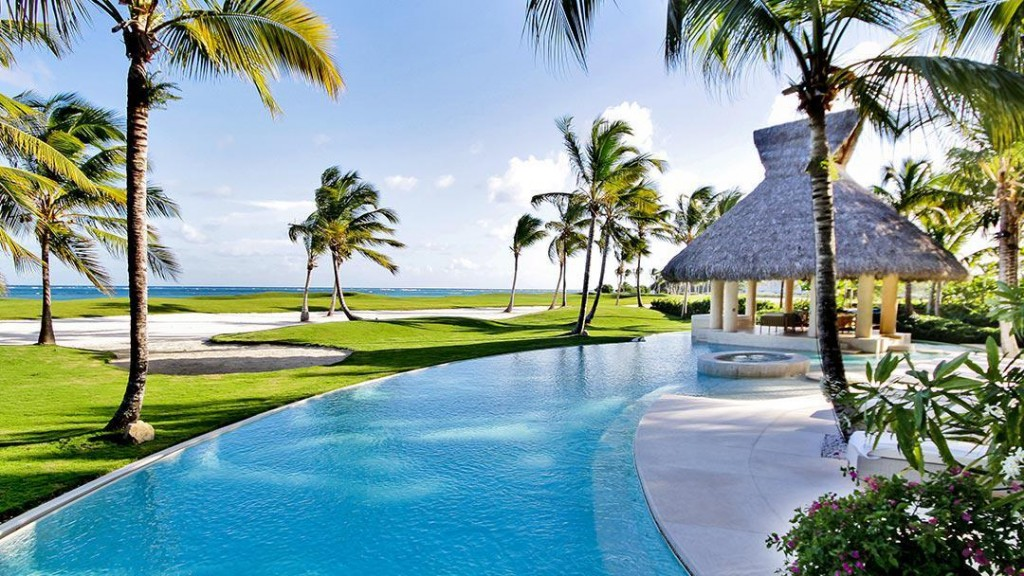 A Caribbean luxury villa next to a golf course