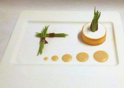 Goat cheese with peach vinaigrette and wheatgrass