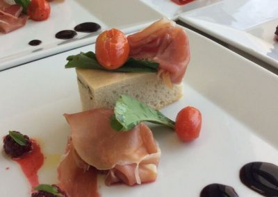Rosemary focaccia with serrano ham, blackberry dressing, cherry tomatoes
