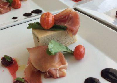Rosemary focaccia with serrano ham, blackberry dressing, cherry tomatoes