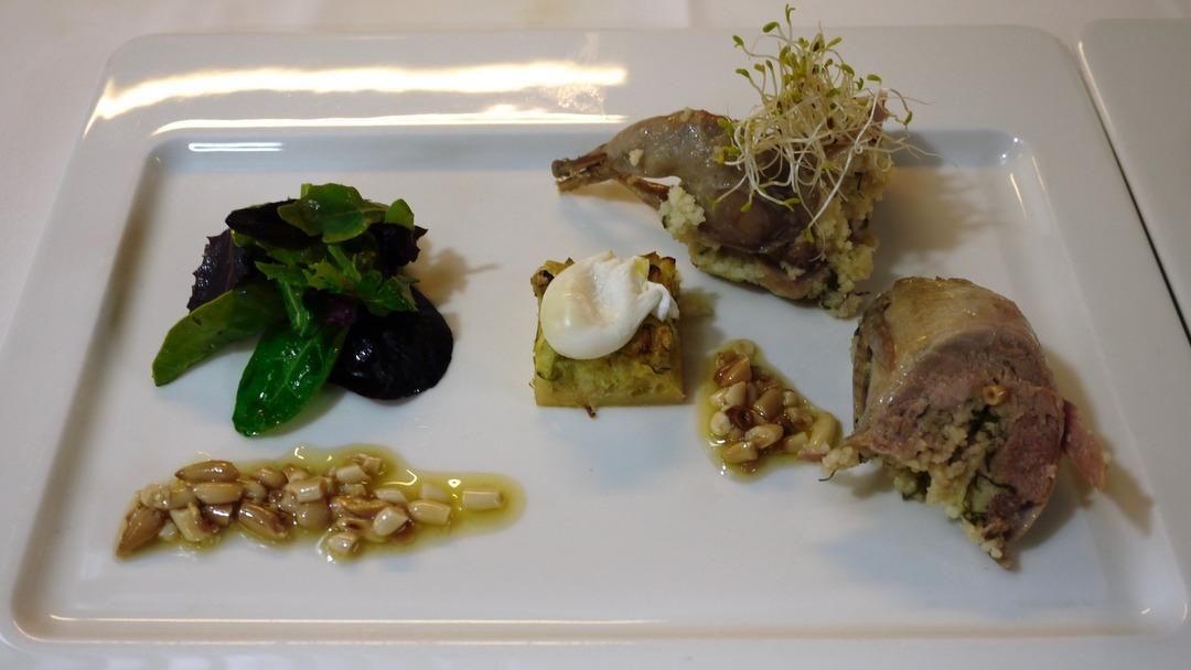 Quail filled with couscous, poached quail egg, leek quicke, pineapple vinaigrette