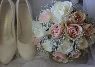 Shoes and bridal bouquet