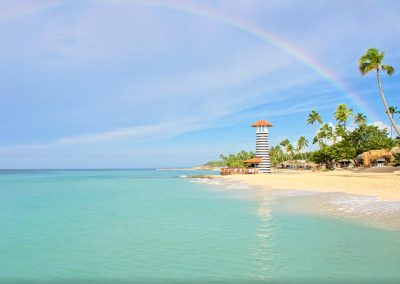 Beach area with bar and lighthouse at the all inlusive hotel Iberostar Hacienda Dominicus in Bayahibe, Dominican Republic