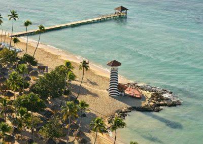 Beach area and Faro at the all-inclusive hotel Iberostar Hacienda Dominicus in Bayahibe