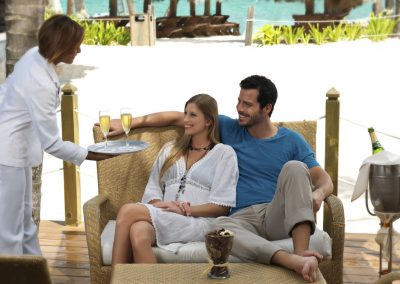 Honeymoon couple in the Privilege loung of the all inlusive hotel Ocean Blue and Sand iin Punta Cana, Dominican Republic