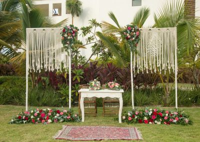 Boho wedding ceremony in the tropical garden of the adults only all-inclusive hotel Secrets Cap Cana in Punta Cana, Dominican Republic