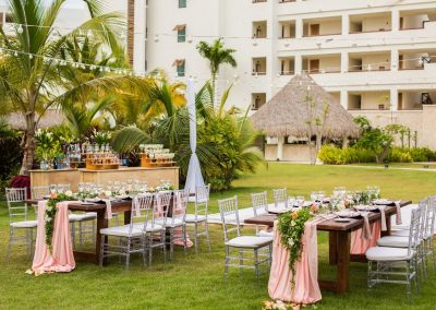 Stunning set-up for a wedding reception in the tropical garden of the adults only all-inclusive hotel Secrets Cap Cana in Punta Cana, Dominican Republic