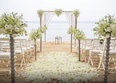 Beachfront wedding ceremony at the all-inclusive hotel Emotions by Hodelpa in Puerto Plata, Dominican Republic