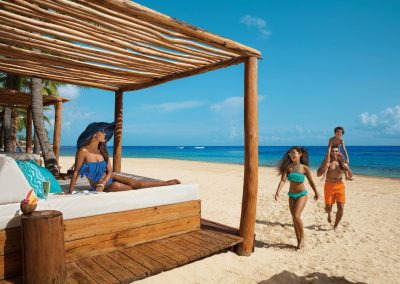 Family Day Bed by the beach of the all inclusive hotel Dreams Punta Cana in the Dominican Republic