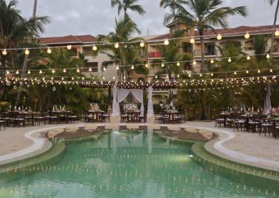 Beautiful wedding reception by the pool of the all inclusive hotel Now Larimar in Punta Cana, Dominican Republic