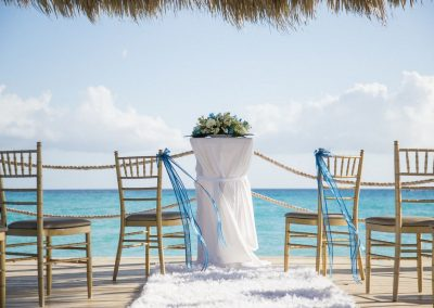 Intimate wedding ceremony set-up on the pier at the all-inclusive hotel Dreams Dominicus La Romana in Bayahibe